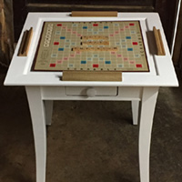 "Rescued Wares » ""Milton"" and his twin, ""Bradley,"" were a set of tables with wood finishes resistant to restoration. So I rocked the white paint and staged them anew for game nights!"