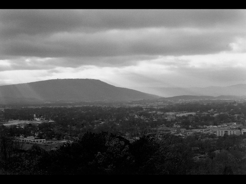 Battles for Chattanooga: [1996] Lookout Mountain flooded by sunrays and looming over the city on November 25, 1996, a cloudy moody day