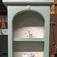 """Rescued Wares » Here is a lovely little curio shelf I found at a second hand store. I painted her the same color as """"Archie"""" and named her """"Midge."""" Fans of the comic will understand. :)"""