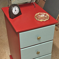 """Rescued Wares » """"Ambrose"""" is from a thrift store. Covered in stickers, wax and sporting a burn mark, he must have had quite a history. A colorful paint job and brass knobs renewed him!"""