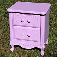 Rescued Wares » Portia was a castaway found on the curb near a vacated house. She was crayon-scribbled, missing a pull, and generally beat to hell. Now she's sassy in solid lilac pink!